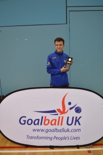 Liam with the Goalfix Cup medal