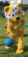 Pudsey Bear throwing the ball