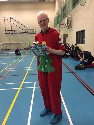 Adam in Santa onesie